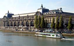Paris Canal Croisieres boat on the Seine River, in front of Orsay Museum